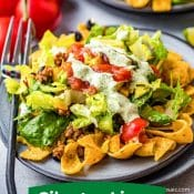 1-Photo Pin for Taco Salad with Cilantro Lime Dressing with red label and white text with a subheading with a green background with white text. Photo of 2 serving plates of taco salad.