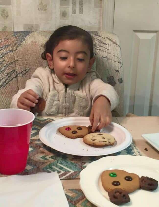 Maria enjoying Reindeer and chocolate mint cookies