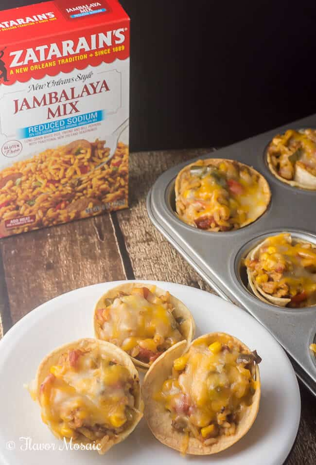 Tex Mex Jambalaya Taco Cups combine Cajun / Creole Jambalaya with Tex Mex seasonings and serves it up in bite sized corn tortilla taco cups.
